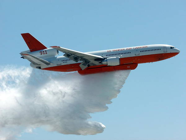 Photograph - Dc10 Aerial Tanker Dropping Water by Jeff Lowe