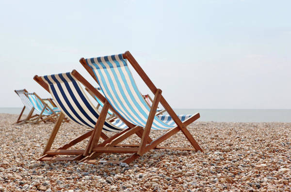 Deck Chair Photograph - Deck Chairs On Beach by Richard Newstead