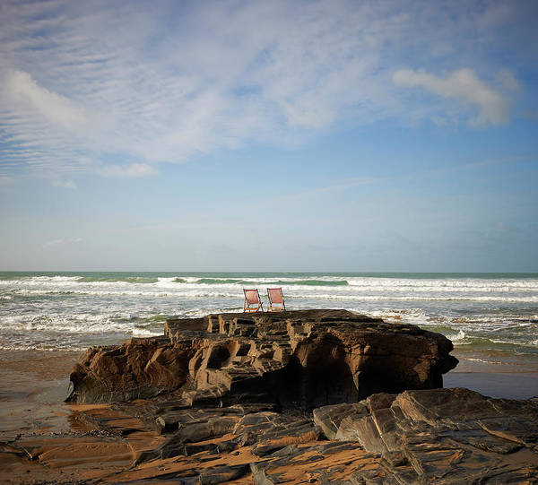 Deck Chair Photograph - Deck Chairs On Coastal Rock Looking Out by Dougal Waters