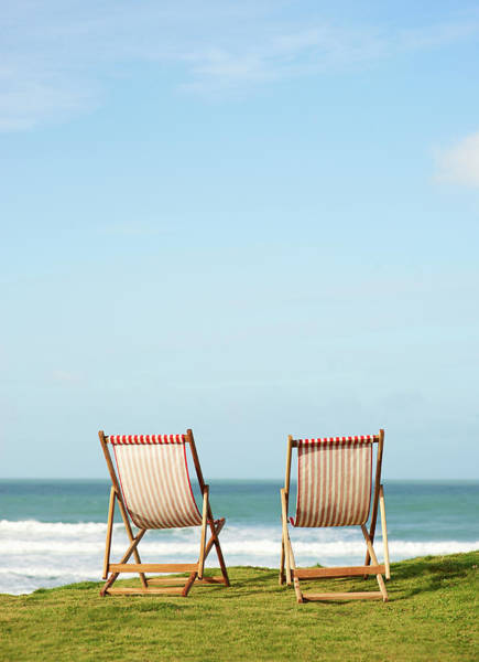 Deck Chair Photograph - Deck Chairs On Coastline Facing Out To by Dougal Waters