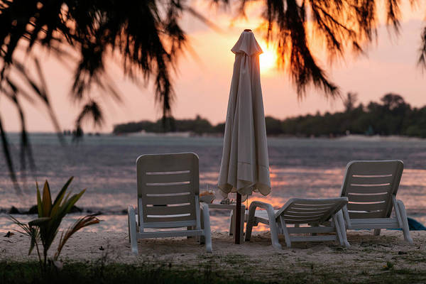 Wall Art - Photograph - Deckchairs And Parasol On Beach by Konstantin Trubavin