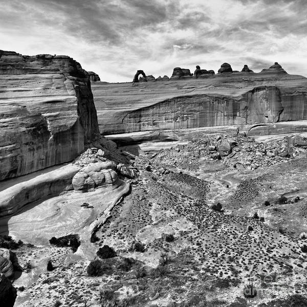 Desert Varnish Photograph - Delicate Arch In The Distance In Monochrome - Arches National Park - Moab Utah by Silvio Ligutti