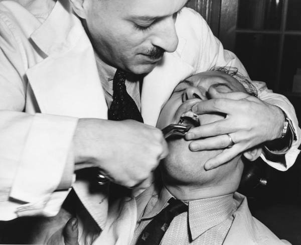 Wall Art - Photograph - Dental Tooth Extraction by Underwood Archives
