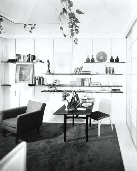 Desk Photograph - Desk By Shelving by Pedro E. Guerrero