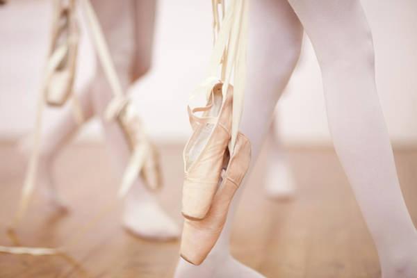Arrival Photograph - Detail Of Ballerinas Legs Leaving Dance by Zero Creatives