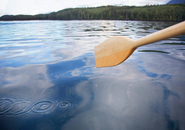 Oar Photograph - Detail View Of Paddle In Ocean by Grant Faint
