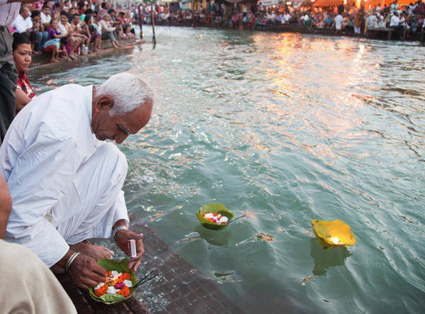Ganges River Photograph - Devotees Performing Rituals At A Ghat by Exotica.im