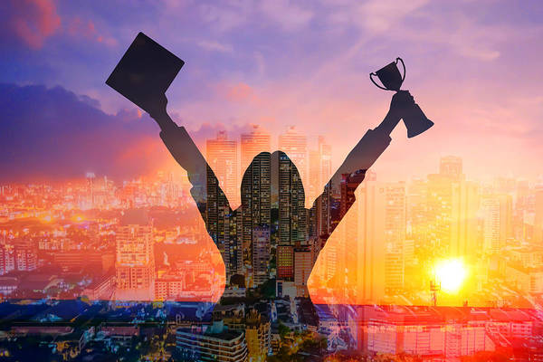 Digital Composite Image Of Woman Holding Award And Cityscape Against Sky During Sunset Art Print by Jirapatch Iamkate / EyeEm