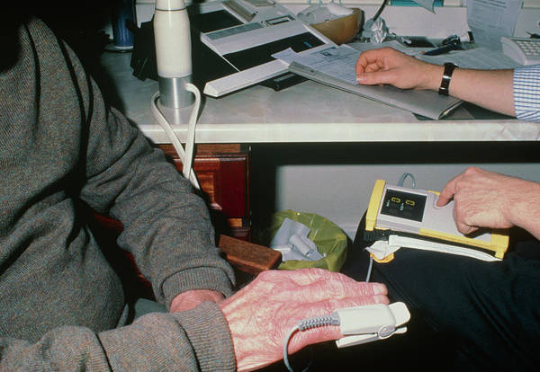 Pulse Photograph - Digital Oximeter Used On Finger Of Elderly Man by Science Photo Library