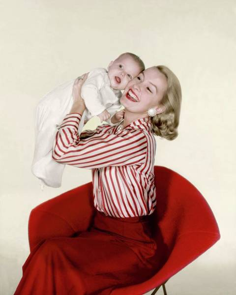 Designer Clothing Photograph - Dina Merrill Holding A Baby by John Rawlings