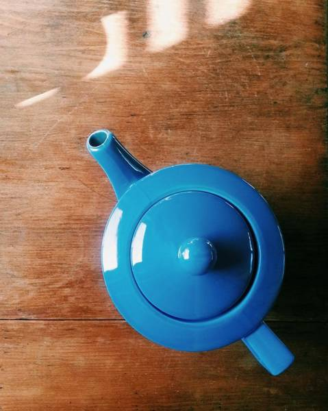 Teapot Photograph - Directly Above Shot Of Teapot On Table by Timothy Kirman / Eyeem