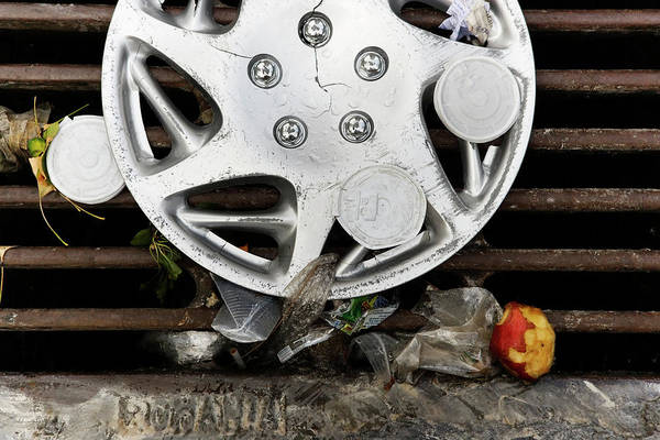 Storm Drain Photograph - Discarded Hubcap And Litter On A Storm by Ron Koeberer