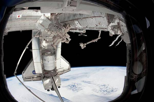 Iss Photograph - Discovery Docked With The Iss by Nasa/science Photo Library