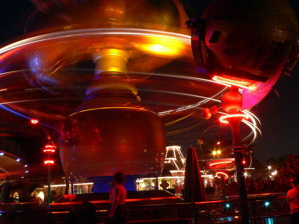Photograph - Disneyland Blurry At Night by Jeff Lowe