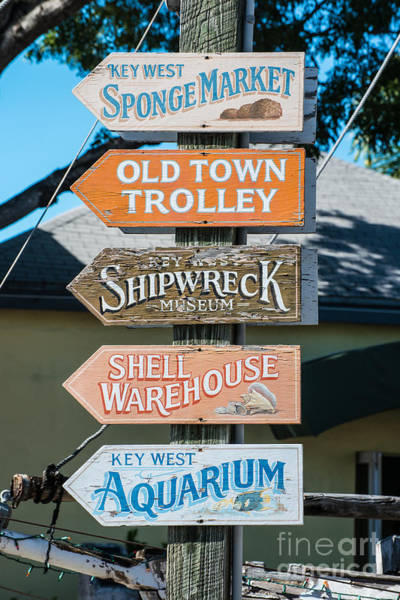 Street Performers Photograph - Distressed Key West Sign Post by Ian Monk