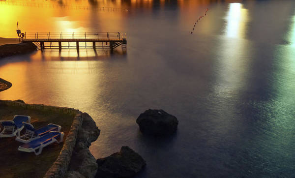 Waters Edge Wall Art - Photograph - Dock On The Ocean With Lights And Beach by Sherif A. Wagih (s.wagih@hotmail.com)