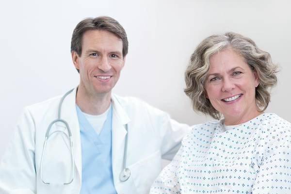 Wall Art - Photograph - Doctor And Female Patient Smiling Towards Camera by Science Photo Library