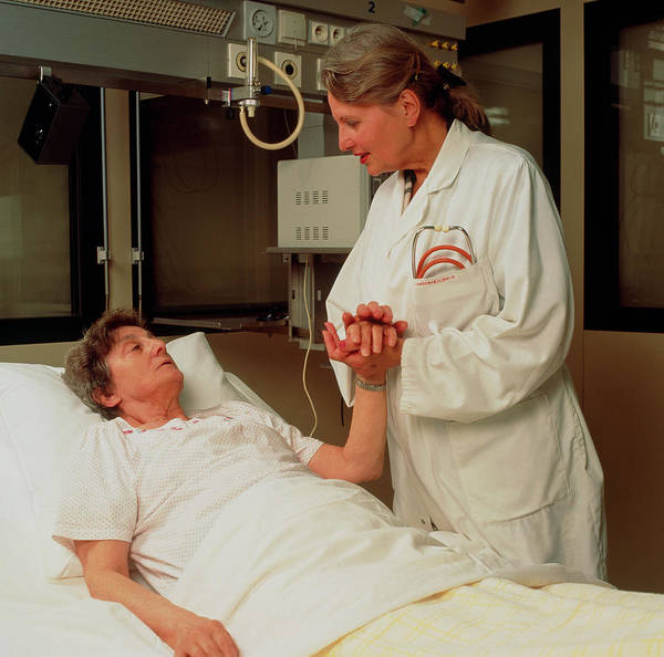 Attending Wall Art - Photograph - Doctor Attends Elderly Woman In A Geriatric Ward by Cc Studio/science Photo Library