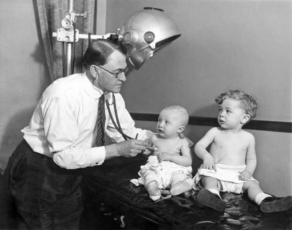 Afraid Photograph - Doctor Examines Baby by Underwood Archives