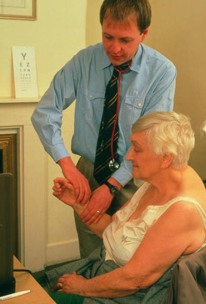 Pulse Photograph - Doctor Measuring Radial Pulse Of An Elderly Woman by Hattie Young/science Photo Library