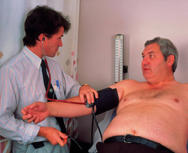 Blood Pressure Wall Art - Photograph - Doctor Takes The Blood Pressure Of An Obese Man by Simon Fraser/science Photo Library