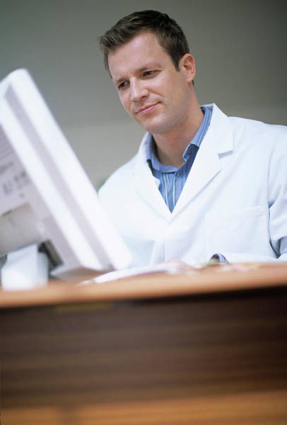 Doctor Office Photograph - Doctor Typing Notes by Ian Hooton/science Photo Library