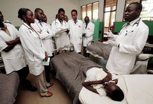 Uganda Wall Art - Photograph - Doctors On A Hospital Ward by Mauro Fermariello/science Photo Library