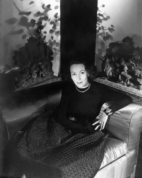 Silhouette Photograph - Dolores Del Rio Sitting In An Armchair by Horst P. Horst