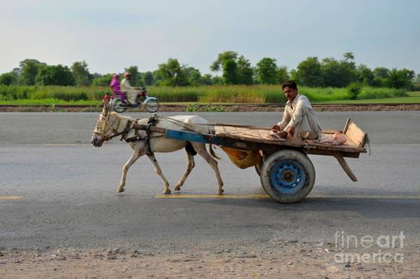 Photograph - Donkey Cart Driver And Motorcycle On Pakistan Highway by Imran Ahmed