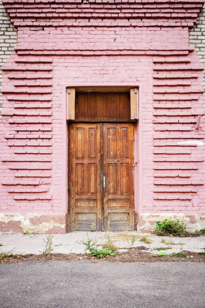 Brick Wall Photograph - Door In A Pink Wall by Wylius