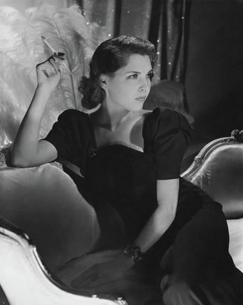 Furniture Photograph - Dorothy Hart Hirshon Wearing A Schiaparelli Dress by Horst P. Horst