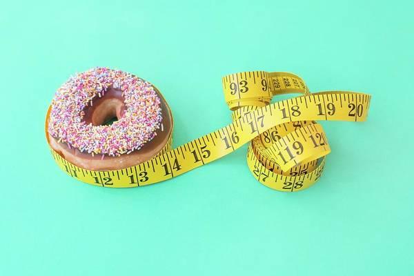 Indulgence Photograph - Doughnut And Tape Measure by Ian Hooton/science Photo Library