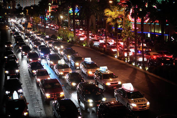 Wall Art - Photograph - Downtown Traffic At Night by Ron Koeberer