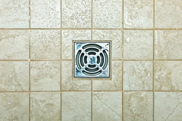 Glazed Tiles Photograph - Drain Hole by Tom Gowanlock