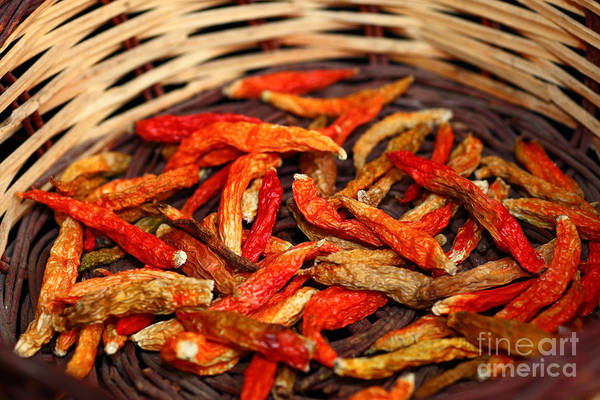 Photograph - Dried Capsicum Annuum Chilis In Basket by James Brunker