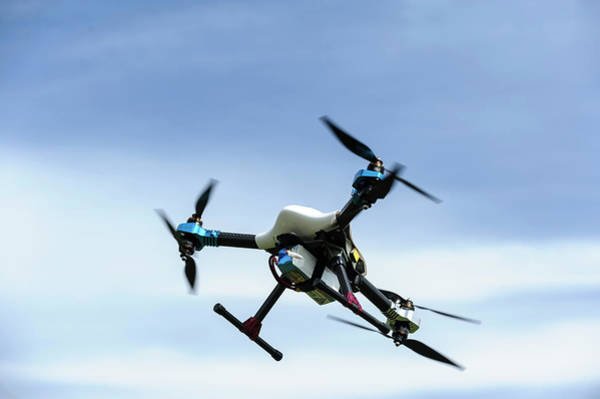 Copter Photograph - Drone In Flight by Jmquinet/reporters/science Photo Library