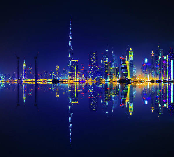 Shopping Districts Wall Art - Photograph - Dubai Skyline Reflection At Night by Serts
