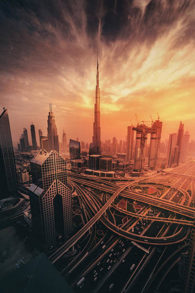 Modern Architecture Photograph - Dubai's Fiery Sunset by David George