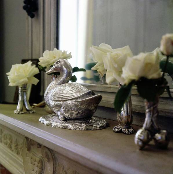 Wall Art - Photograph - Duck Ornament On A Mantelpiece by Horst P. Horst