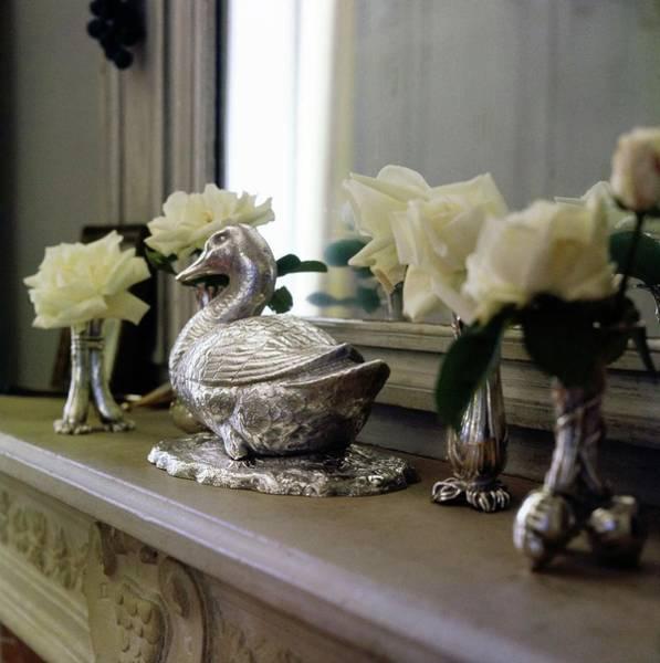 Fragility Photograph - Duck Ornament On A Mantelpiece by Horst P. Horst