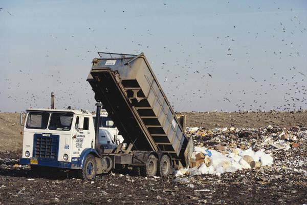 Dump Truck Photograph - Dumping Garbage Into Landfill by David Weintraub