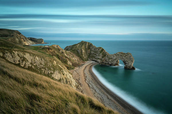 Natural Arch Photograph - Durdle Door At Sunset by Fotosearch