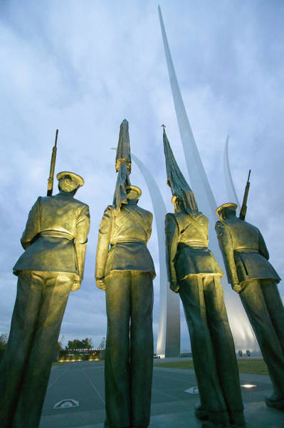 Honor Guard Photograph - Dusk Light Behind Bronze Honor Guard by Panoramic Images
