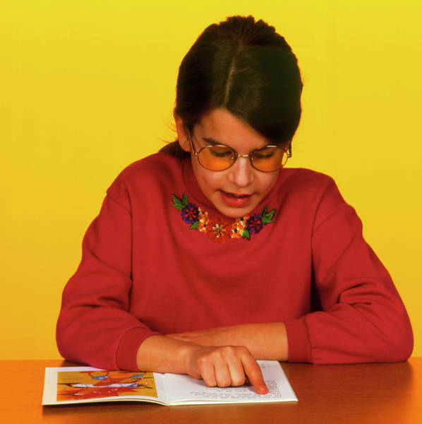 Lenses Photograph - Dyslexic Girl Wears Irlen Lenses To Read A Book by Alex Bartel/science Photo Library