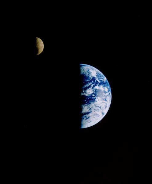 Wall Art - Photograph - Earth & Moon Seen From The Galileo Probe by Nasa/science Photo Library