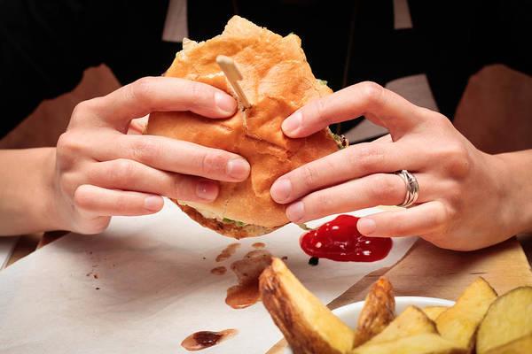 Buns Photograph - Eating Burger by Tom Gowanlock