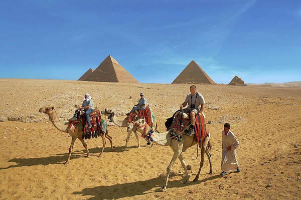 Ancient Egypt Photograph - Egypt, Cairo, Giza, Tourists Ride by Miva Stock