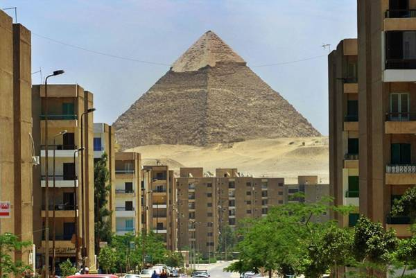 Wall Art - Photograph - Egyptian Pyramid With Modern City by Peter Menzel/science Photo Library