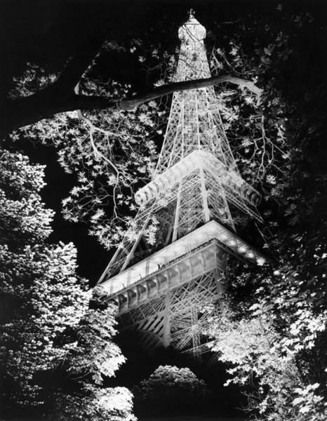 Awe Photograph - Eiffel Tower At Night by Underwood Archives