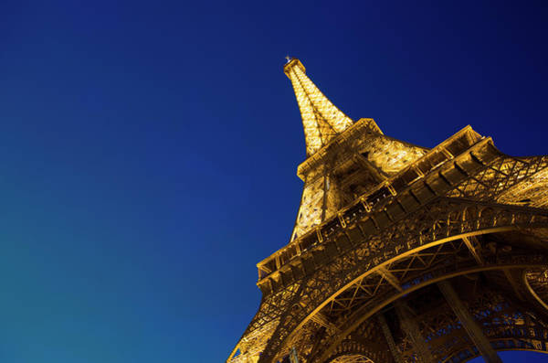 Photograph - Eiffel Tower In Paris Illuminated At by Tony Burns